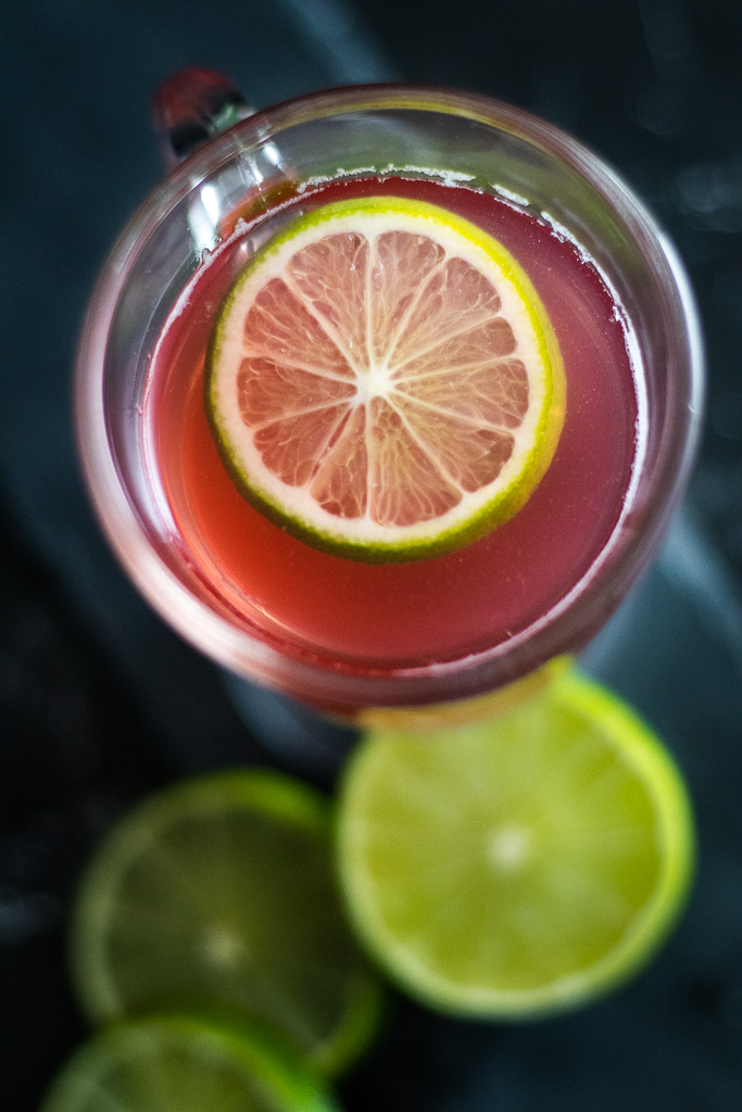 Gin Toddy - top down view of pink toddy with lime garnish