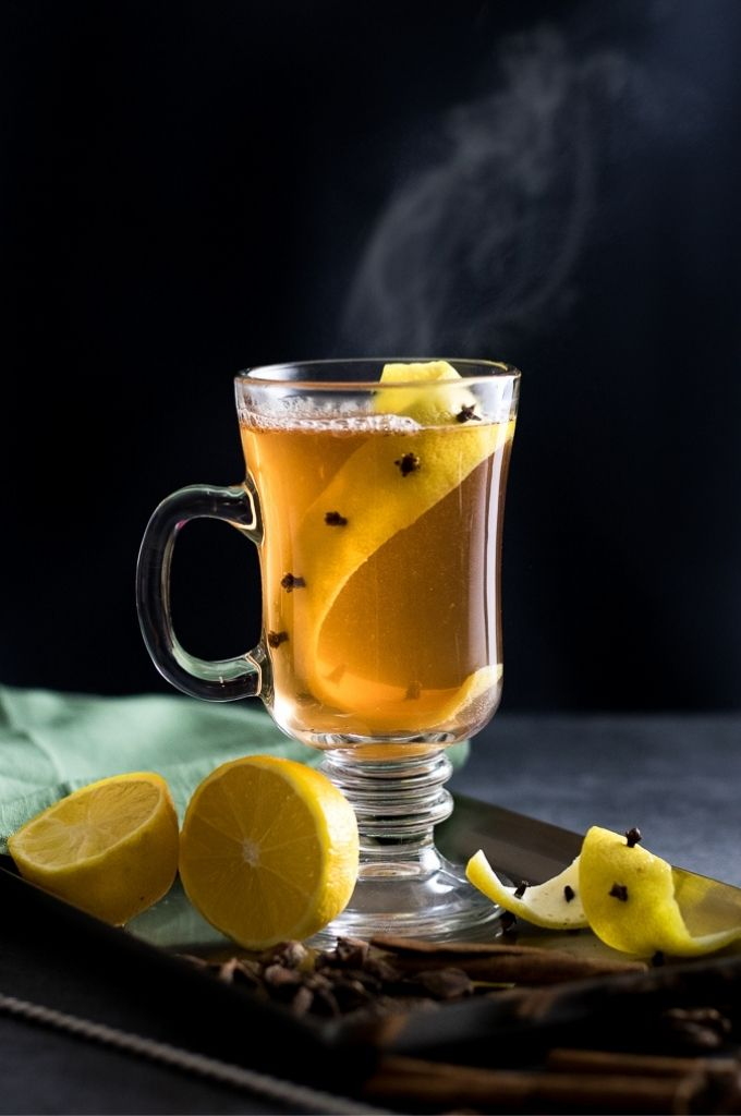 Easy Hot Toddy with lemon peel and clove garnish