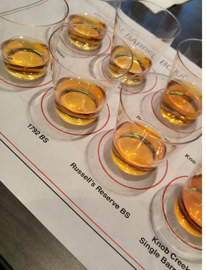 Bourbon flight of single barrel selections in small shot glasses