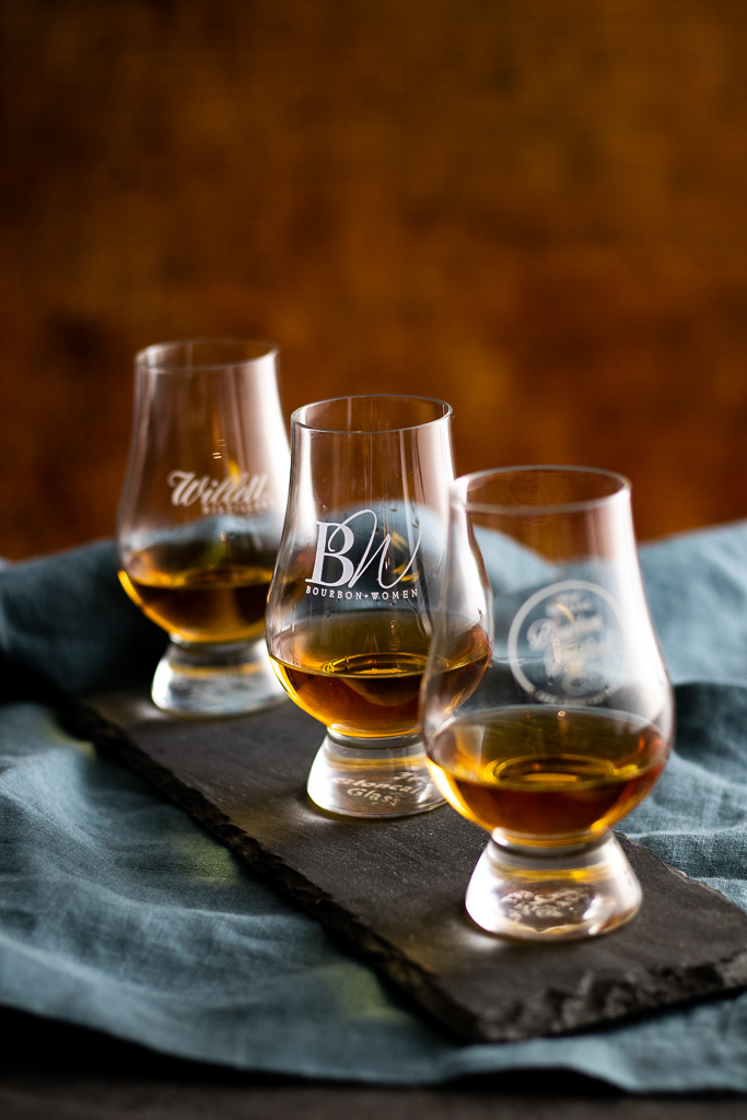bourbon in three glencairns on a slate tray