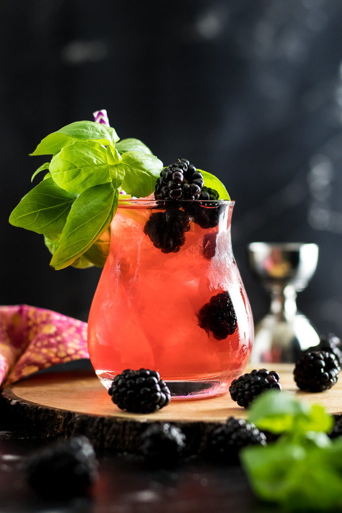Blackberry Basil Julep - dark pink cocktail in a rocks glass with blackberry and basil garnish
