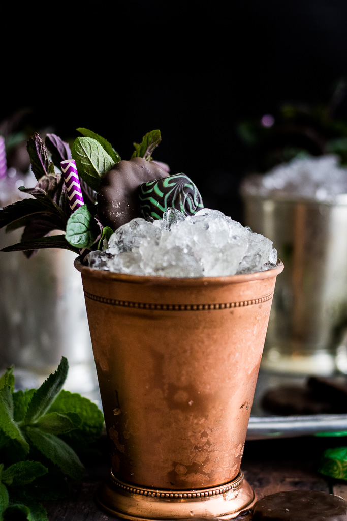 Chocolate mint julep in a copper mint julep cup garnished with mint, thin mint cookie and chocolate mint candy