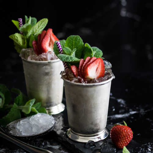 Strawberry mint julep - 2 in silver mint julep cups with mint and strawberry garnish