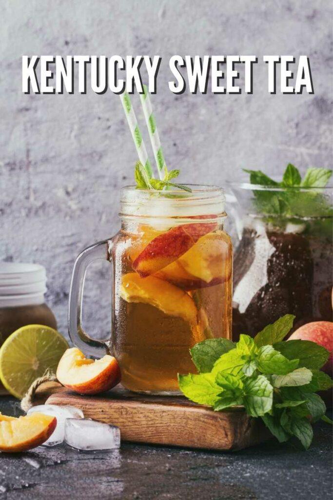 Kentucky iced Tea in a mason jar mug on a cutting board with mint, peach