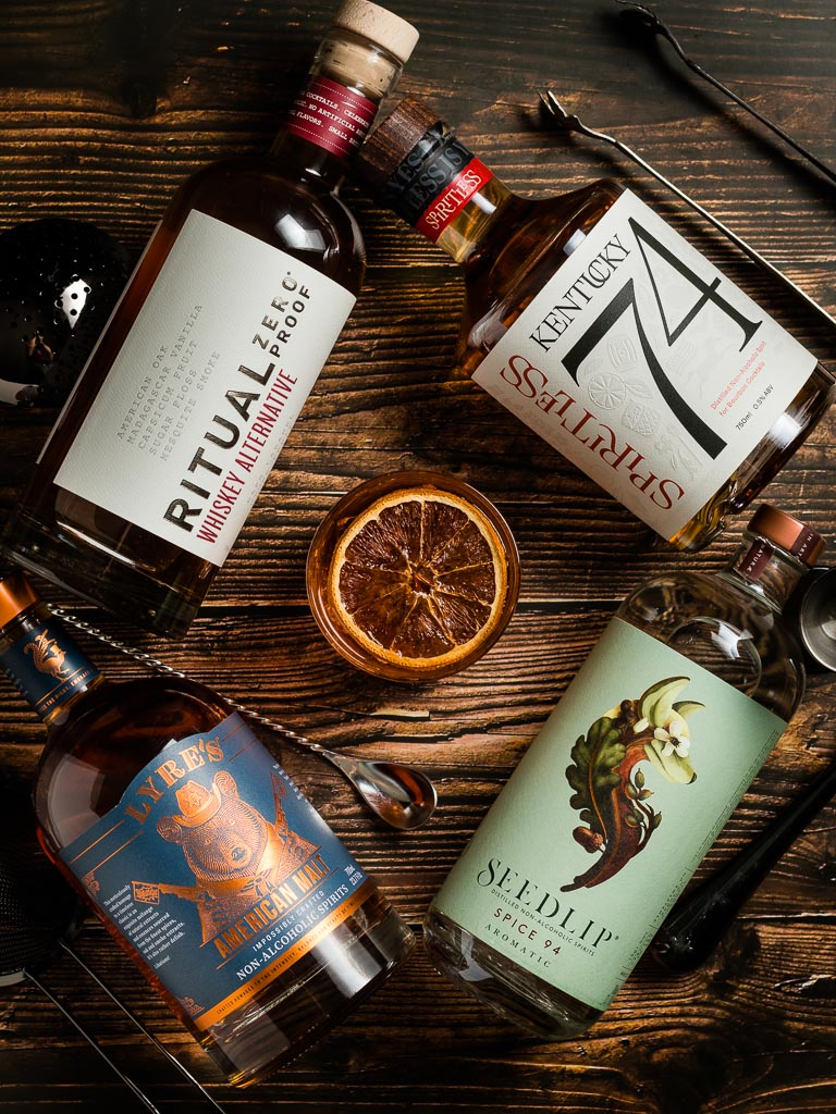 Non-Alcoholic Whiskey Alternatives for Whiskey Mocktails - Bottles of Lyre's, Seedlip Spice, Ritual Zero Proof and Kentucky 74