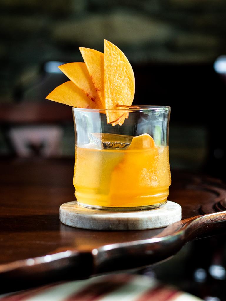 Peach Old Fashioned with peach fan garnish