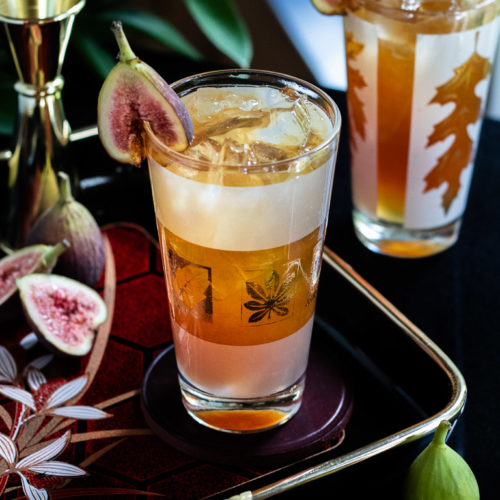 Fig Fall Amaro Highball - in a highball glass garnished with a fresh fig garnish