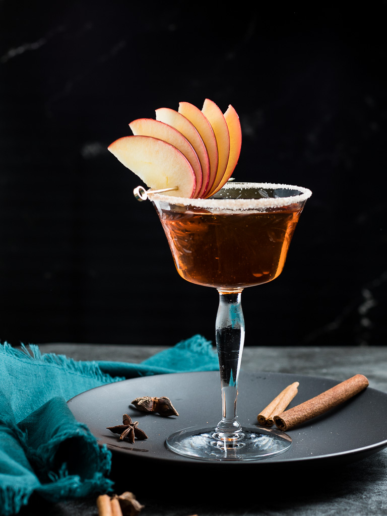 Apple Manhattan in a vintage coupe glass with apple fan garnish